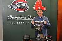 Darren Fenster, outgoing manager of the Greenville Drive, poses with the 2017 South Atlantic League championship trophy during the annual Hot Stove Event to promote the upcoming 2018 baseball season on Monday, January 29, 2018, at Fluor Field at the West End in Greenville, South Carolina. (Tom Priddy/Four Seam Images)