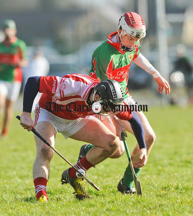 Aidan Mc Grath of Eire Og in action against David O Brien of Clooney-Quin during their U-21A championship game in Clarecastle. Photograph by John Kelly.