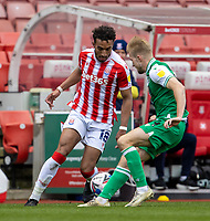 5th April 2021; Bet365 Stadium, Stoke, Staffordshire, England; English Football League Championship Football, Stoke City versus Millwall; Jacob Brown of Stoke City cuts inside Billy Mitchell of Millwall along the wing