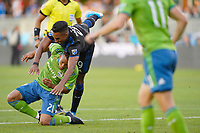 SAN JOSE, CA - SEPTEMBER 30: Danny Hoesen #9 of the San Jose Earthquakes collides with Jordy Delem #21 of the Seattle Sounders FC during a Major League Soccer (MLS) match between the San Jose Earthquakes and the Seattle Sounders on September 30, 2019 at Avaya Stadium in San Jose, California.