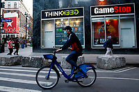 NEW YORK, NEW YORK - FEBRUARY 25: A man rides his bike in front of GameStop at 6th Avenue on February 25, 2021 in New York. GameStop Corp. doubled its shares and and jumped another 19% today and the betting are that GameStop shares would spike to $800 on Friday. (Photo by John Smith/VIEWpress via Getty Images)