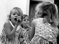 Little girls playing with lipstick