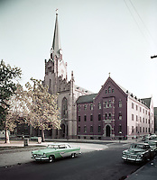 St. Boniface Church exterior photograph from 1959. Old cars out front.