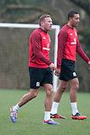 Cardiff - UK - 19th March 2013 : Craig Bellamy alongside Lewin Nyatanga during a Wales football squad training session at the Vale Hotel near Cardiff ahead of their game with Scotland at the weekend.