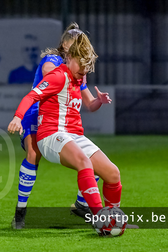 Gent's defender Lindsey Van Belle (14) and Standard forward Davinia Vanmechelen (25) pictured during a female soccer game between  AA Gent Ladies and Standard Femina de Liege on the 8 th matchday of the 2020 - 2021 season of Belgian Scooore Womens Super League , friday 20 th of November 2020  in Oostakker , Belgium . PHOTO SPORTPIX.BE | SPP | STIJN AUDOOREN