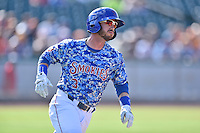 Tennessee Smokies second baseman Stephen Bruno (3) runs to first during a game against the Birmingham Barons on August 2, 2015 in Kodak, Tennessee. The Smokies defeated the Barons 5-2. (Tony Farlow/Four Seam Images)