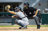 Pawtucket Red Sox catcher Blake Swihart (2) reaches for a high pitch as home plate umpire Jon Berry looks on during the game against the Charlotte Knights at BB&T Ballpark on August 9, 2014 in Charlotte, North Carolina.  The Red Sox defeated the Knights  5-2.  (Brian Westerholt/Four Seam Images)
