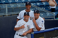 Staten Island Yankees Anderson Munoz (left), Alfredo Garcia (right), and Nelvin Correa (back) before a NY-Penn League game against the Aberdeen Ironbirds on August 22, 2019 at Richmond County Bank Ballpark in Staten Island, New York.  Aberdeen defeated Staten Island 4-1 in a rain shortened game.  (Mike Janes/Four Seam Images)