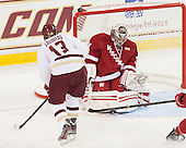 Johnny Gaudreau (BC - 13), Adam Miller (Wisconsin - 31) - The Boston College Eagles defeated the visiting University of Wisconsin Badgers 9-2 on Friday, October 18, 2013, at Kelley Rink in Conte Forum in Chestnut Hill, Massachusetts.