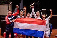Den Bosch, The Netherlands, April 17, 2021,    Maaspoort, Billie Jean King Cup  Netherlands -  China , seccond day doubles match: The Dutch team celebrates their win over China 3-2, ltr: captain Paul Haarhuis, Arantxta Rus , Lesley Pattinama , Kiki Bertens and Demi Schuurs (NED)  celebrate,  they defeted China 3-2<br /> Photo: Tennisimages/Henk Koster