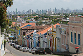 Olinda, Pernambuco State, Brazil. Rua quinze de Novembro, looking WSW towards Recife; colourful colonial shops.