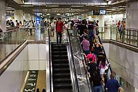 Singapore MRT Mass Rapid Transit Patrons on Escalator.