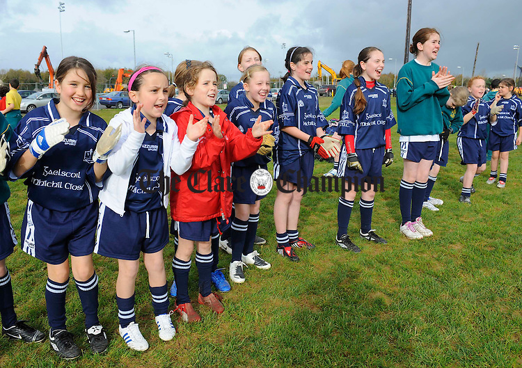The girls from Gaelscoil Mhichil Ciosog cheer on their team at the Clare Champion, Primary Schools Finals in Lees Road. Photograph by John Kelly.