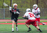 WOLCOTT, CT 050521JS14—Watertown's Alex Daponte (4) fires a shot past Wolcott's Tyler Paquet (24) and Jay Thibeau (4) during their game Wednesday at Wolcott High School.<br /> Jim Shannon Republican American