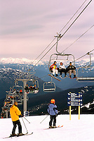 Skiers and Snowboarders on Chair Lift, Downhill skiing and Snowboarding on Whistler Mountain, Whistler Ski Resort, BC, British Columbia, Canada - Coast Mountains