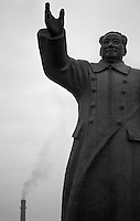 A monument to Mao stands guard outside Wuhan Iron and Steel, an industrial mill that industrialized China.