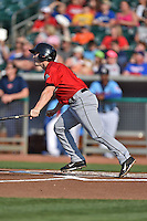 Birmingham Barons third baseman Chris Curley #4 swings at a pitch during a game against the Tennessee Smokies at Smokies Park on May 31, 2014 in , Tennessee. The Barons defeated the Smokies 2-1. (Tony Farlow/Four Seam Images)