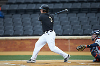 Bobby Seymour (3) of the Wake Forest Demon Deacons follows through on his swing against the Illinois Fighting Illini at David F. Couch Ballpark on February 16, 2019 in  Winston-Salem, North Carolina.  The Fighting Illini defeated the Demon Deacons 5-2.  (Brian Westerholt/Four Seam Images)