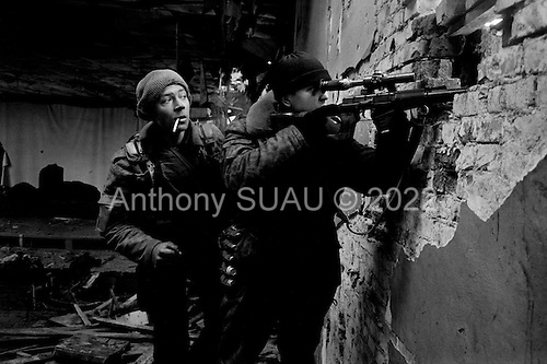 Grozny, Chechyna.January 1995.Russian snipers scoop out the South side of the river in central Grozny where Chechen forces still control much of the area. These soldiers are at a post in an old movie theater directly facing the river.