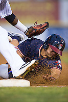 Juan Yepez (2) of the Rome Braves slides head first into third base as Frandy De La Rosa (4) of the Hickory Crawdads can't handle the throw at L.P. Frans Stadium on May 12, 2016 in Hickory, North Carolina.  The Braves defeated the Crawdads 3-0.  (Brian Westerholt/Four Seam Images)