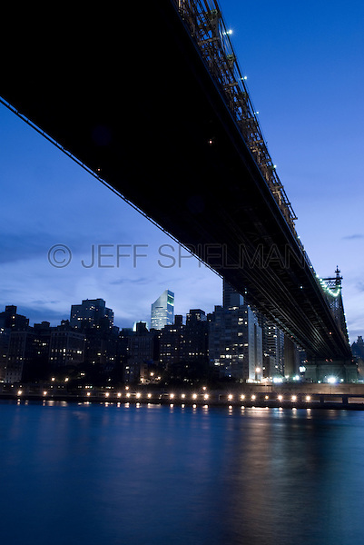 AVAILABLE FROM JEFF AS A FINE ART PRINT.<br /> <br /> AVAILABLE FROM PLAINPICTURE.COM FOR COMMERCIAL AND EDITORIAL LICENSING.  Please go to www.plainpicture.com and search for image # p5690174.<br /> <br /> Queensboro Bridge, East River and Midtown Manhattan Skyline at Dusk, New York City, New York State, USA