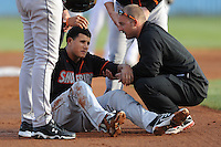 Delmarva Shorebirds Manny Machado #21 is assisted off the field after going down with a knee injury in the first inning during  a game against  the  Asheville Tourists at McCormick Field in Asheville,  North Carolina;  May 5, 2011. The Tourists won the game 10-2.  Photo By Tony Farlow/Four Seam Images