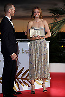 CANNES, FRANCE - JULY 17: Joachim Trier and Renate Reinsve poses with 'Best Actress Award' for 'The Worst Person in the World' during the 74th annual Cannes Film Festival on July 17, 2021 in Cannes, France. . <br /> CAP/GOL<br /> ©GOL/Capital Pictures