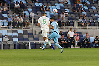 SAINT PAUL, MN - MAY 1: Matt Besler #5 of Austin FC and Emanuel Reynoso #10 of Minnesota United FC battle for the ball during a game between Austin FC and Minnesota United FC at Allianz Field on May 1, 2021 in Saint Paul, Minnesota.