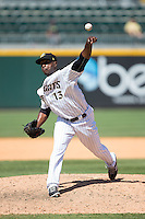 Charlotte Knights relief pitcher Onelki Garcia (13) in action against the Indianapolis Indians at BB&T BallPark on June 21, 2015 in Charlotte, North Carolina.  The Knights defeated the Indians 13-1.  (Brian Westerholt/Four Seam Images)