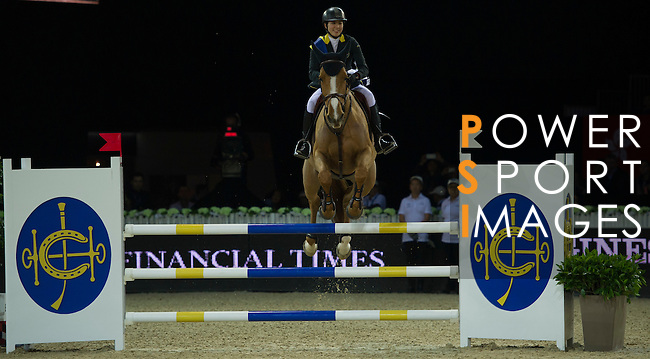 Jacqueline Lai during jump over the HKJC fence during the HKJC Race of the Rider during the Longines Masters of Hong Kong on 19 February 2016 at the Asia World Expo in Hong Kong, China. Photo by Juan Manuel Serrano / Power Sport Images