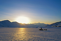 Snow machine rider, Canwell Glacier, Alaska mountain range, Alaska.