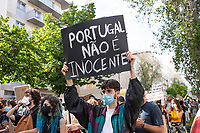 LISBON, PORTUGAL JUNE 06: Protesters hold up posters  against police violence during a protest against racism and in favor of respect for life in in Lisbon, on June 6, 2020. <br /> Protesters mourn the death of African-American George Floyd after a Minneapolis police officer knelt on his neck.<br /> (Photo by Luis Boza/VIEWpress))