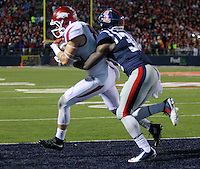 11/7/15<br /> Arkansas Democrat-Gazette/STEPHEN B. THORNTON<br /> Arkansas' Drew Morgan pulls in the final TD pass in overtime  as he is defended by  Ole Miss's Mike Hilton during  Saturday's game in Oxford, Miss.