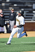 Logan Farrar (8) of the VCU Rams rounds third base on his way to scoring a run against the Georgetown Hoyas at Wake Forest Baseball Park on February 13, 2015 in Winston-Salem, North Carolina.  The Rams defeated the Hoyas 6-3.  (Brian Westerholt/Four Seam Images)
