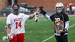 WOLCOTT, CT 050521JS15—Sean Pawlak (14) and Watertown's Shaun Haase (28) show love and respect following Watertown's 18-0 win over Wolcott in lacrosse action Wednesday at Wolcott High School.<br /> Jim Shannon Republican American