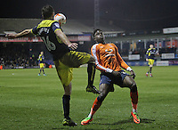 Phil Edwards of Oxford United in action with Pelly-Ruddock Mpanzu of Luton Town during the The Checkatrade Trophy Semi Final match between Luton Town and Oxford United at Kenilworth Road, Luton, England on 1 March 2017. Photo by Stewart  Wright  / PRiME Media Images.