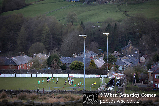 Bacup Borough 4 Holker Old Boys 1, 25/04/2016. Brain Boys West View Stadium, NorthWest Counties League Division One. Visiting midfielder Jack O'Leary gives his team the lead in the first-half at the Brain Boys West View Stadium as Bacup Borough (in black) play Holker Old Boys in a NorthWest Counties League division one fixture. Formed as Bacup in 1879, the club moved into their current home in 1889 and have been known as Bacup Borough since the 1920s, apart from a brief recent spell when they added the name Rossendale to their name. With both teams challenging for play-off places, Bacup Borough won this fixture by 4-1, watched by a crowd of 50. Photo by Colin McPherson.