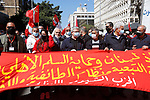 Demonstrators take part in a protest against mounting economic hardships in Beirut, Lebanon March 28, 2021. Supporters of the Lebanese Communist Party marched from Hamra street to Riad Al Solh square in downtown Beirut during a protest near the headquarters of the Prime Minister of Lebanon. The protesters call for the formation of a national coalition against the ruling regime amid an acute economic situation and political impasse. Photo by Marwan Bou Haidar