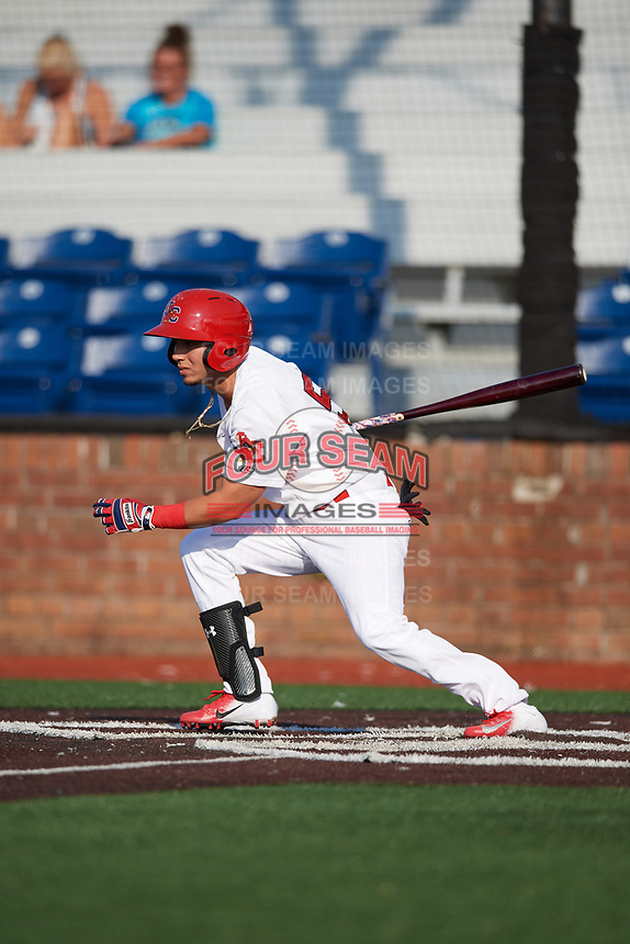 Johnson City Cardinals center fielder Jonatan Machado (51) follows through on a swing during a game against the Danville Braves on July 29, 2018 at TVA Credit Union Ballpark in Johnson City, Tennessee.  Johnson City defeated Danville 8-1.  (Mike Janes/Four Seam Images)