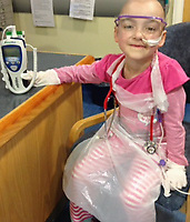 """Pictured: Eva Bevan when she was receiving treatment<br /> Re: A dying schoolgirl told her mum to be brave and stop crying when she started losing her battle with cancer. <br /> Eva Bevan, seven, would roll her eyes at mum Lauri(corr) whenever she broke down in tears.<br /> Single mum Lauri Cowdell, 37, from Ebbw Vale, south Wales said: """"She was braver than me, she kept us all going.<br /> """"If ever I started crying she would roll her eyes the way young girls do at their mums.<br /> """"She was wicked and would say to me: """"You're not crying again mum.""""   <br /> Only child Eva was  fit and healthy before complaining of a pain in her hip and tiredness.<br /> Hospital theatre nurse Lauri took her to the doctor thinking she had hurt herself in a rough and tumble game with her friends."""