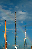 Rainbow over sail boats masts, in Port of Barcelona, Spain