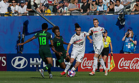 GRENOBLE, FRANCE - JUNE 22: Lina Magull #20 of the German National Team dribbles in a crowd, Halimatu Ayinde #18 of the Nigerian National Team, Francisca Ordega #17 of the Nigerian National Team during a game between Panama and Guyana at Stade des Alpes on June 22, 2019 in Grenoble, France.
