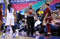 GREENSBORO, NC - MARCH 06: Official Bryan Brunette holds the ball during a game between Boston College and Duke at Greensboro Coliseum on March 06, 2020 in Greensboro, North Carolina.