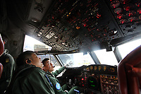 Japanese navy pilots in the cockpit of Japan Maritime Self Defence Force PC3 reconnaissance plane. Okinawa, Japan. 2012