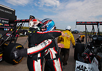 Jun 9, 2019; Topeka, KS, USA; NHRA top fuel driver Billy Torrence (left) congratulates son Steve Torrence after winning the Heartland Nationals at Heartland Motorsports Park. Mandatory Credit: Mark J. Rebilas-USA TODAY Sports