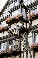 Bad Wimpfen: Fackwerk Facade. Beautiful hanging signage, flower boxes.