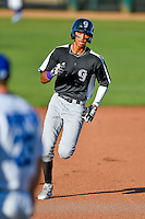 Pedro Gonzalez (22) of the Grand Junction Rockies hustles towards third base against the Ogden Raptors in Pioneer League action at Lindquist Field on June 20, 2016 in Ogden, Utah. The Rockies defeated the Raptors 5-2.(Stephen Smith/Four Seam Images)