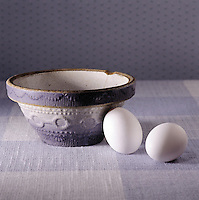 Blue and white study of eggs and a pottery mixing bowl with eggs.