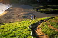 California, Marin County, Muir Beach, GGNRA, Hikers on Coastal Trail above the beach