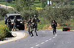 Israeli border policemen run towards Palestinian stone-throwers during clashes outside the West Bank Palestinian village of Awarta near the West Bank city of Nablus, Sunday, April 10, 2011. The Israeli army often carries out raids in West Bank towns and villages searching for wanted militants from the different Palestinian factions. Photo by Wagdi Eshtayah